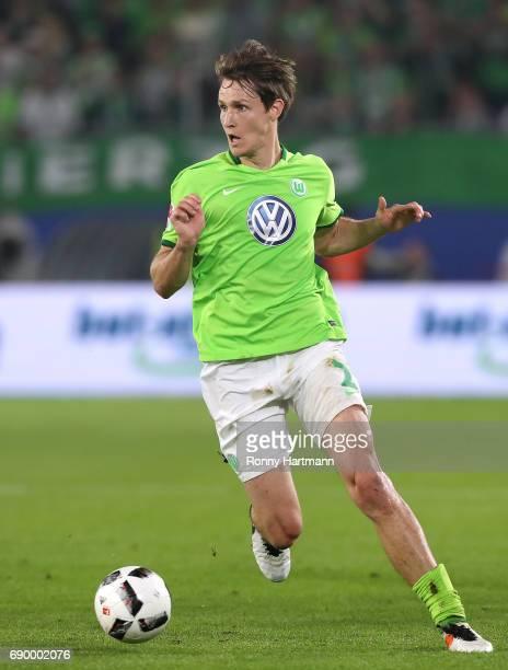 Philipp Wollscheid of Wolfsburg runs with the ball during the Bundesliga Playoff first leg match between VfL Wolfsburg and Eintracht Braunschweig at...
