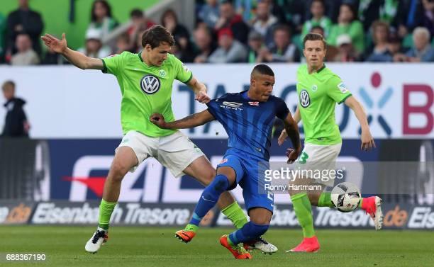 Philipp Wollscheid vies with Onel Hernandez of Braunschweig during the Bundesliga Playoff first leg match between VfL Wolfsburg and Eintracht...