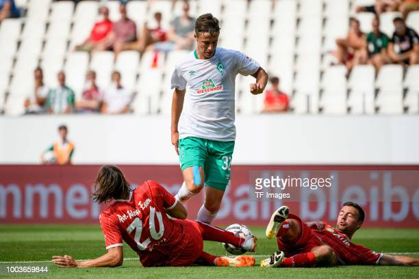 Philipp Zeiger of RotWeiss Essen and Marco Friedl of Werder Bremen Timo Brauer of RotWeiss Essen battle for the ball during the Interwetten Cup match...