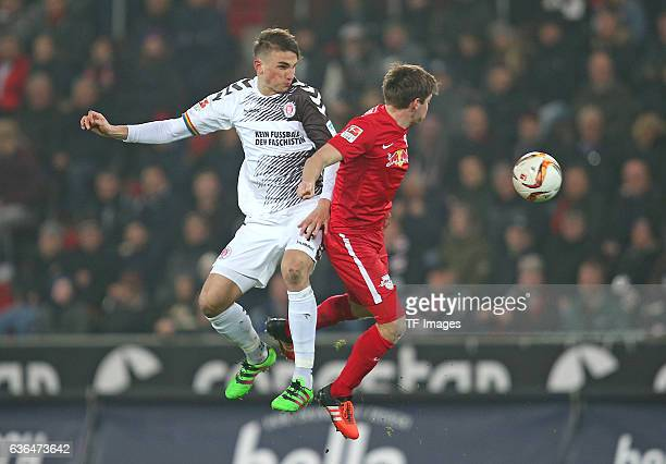 Philipp Ziereis of St Pauli and Dominik Kaiser of RB Leipzig battle for the ball during the Second Bundesliga match between FC St Pauli and...