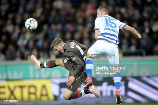 Philipp Ziereis of St Pauli jumps for the ball with John Verhoek of Duisburgduring the Second Bundesliga match between MSV Duisburg and FC St Pauli...
