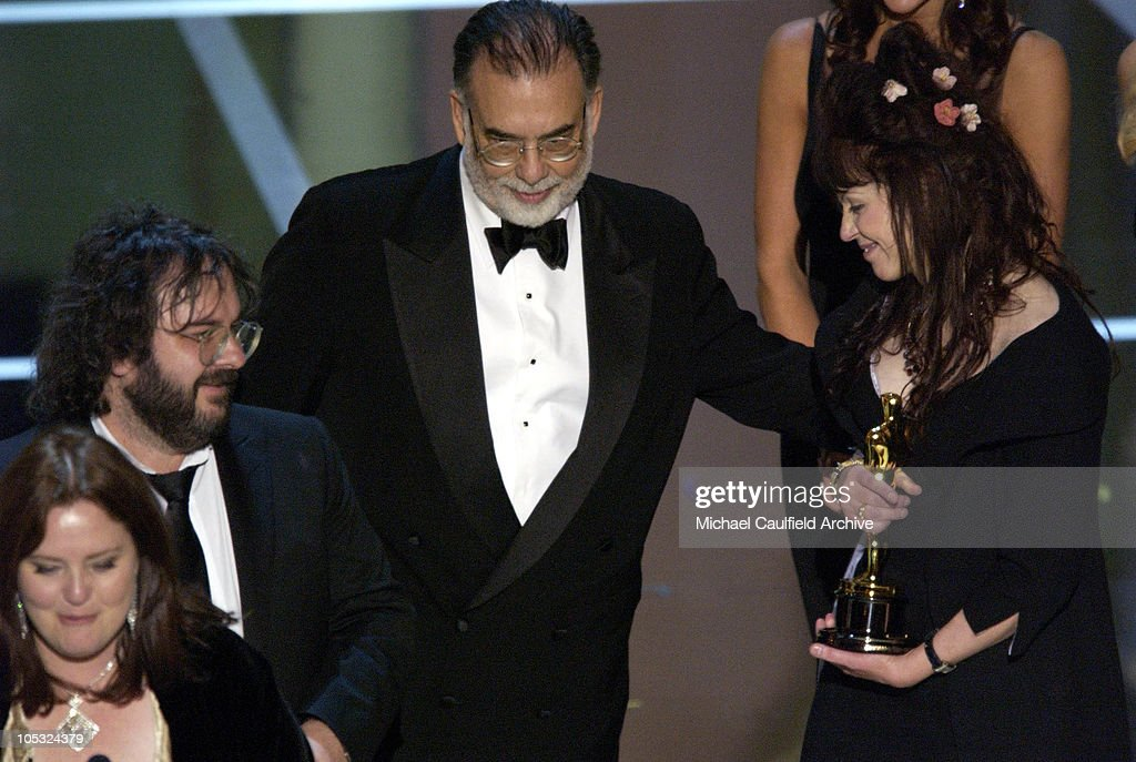 Philippa Boyens, Peter Jackson and Fran Walsh accept their