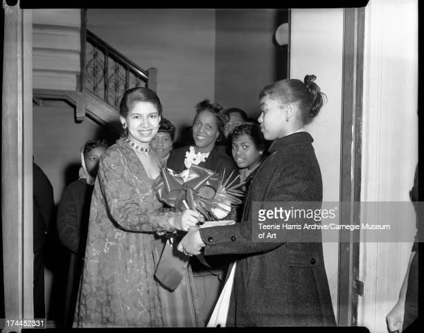 Philippa Duke Schuyler signing autograph for girl in Carnegie Music Hall Pittsburgh Pennsylvania November 10 1958