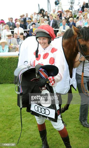 Philippa Holland winner of The Magnonlia Cup rides horse Beat The Bell during Ladies Day at Glorious Goodwood held at Goodwood Racecourse on August 2...
