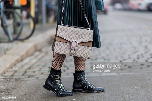 Philippa Sandberg wearing a blue fur jacket green skirt net nights black boots Gucci bag during the MercedesBenz Fashion Week Berlin A/W 2017 at...