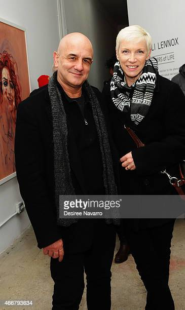Philippe Achard and singer Annie Lennox attend Tali Lennox Exhibition Opening Reception at Catherine Ahnell Gallery on March 18, 2015 in New York...