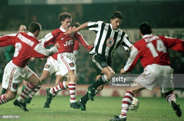 Philippe Albert of Newcastle United takes on the Arsenal defence including Nigel Winterburn and Martin Keown during an FA Carling Premiership match...