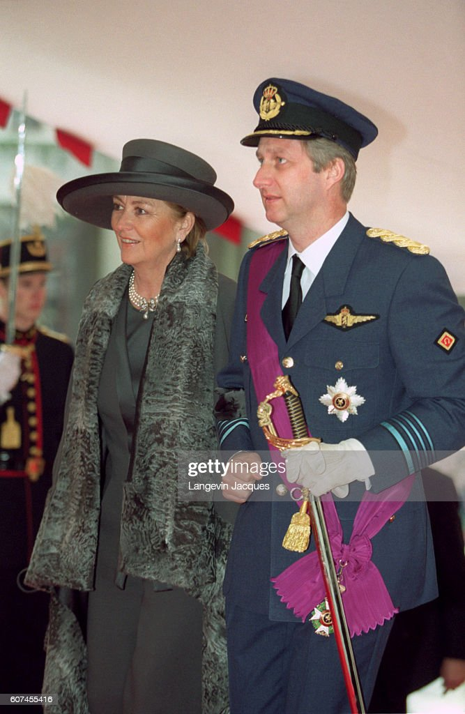 Philippe arrives at St Michel Ste Gudule Cathedral on the arm of his mother Queen Paola.