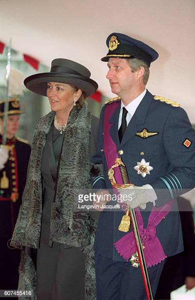 Philippe arrives at St Michel Ste Gudule Cathedral on the arm of his mother Queen Paola