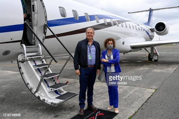 Philippe Bodson and Flemish minister Lydia Peeters pictured during a test flight of the 'Asl Fly Executive' program of ASL Group offering luxurious...