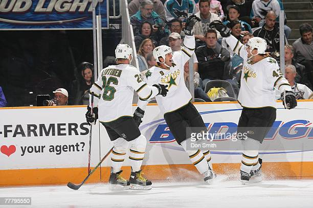 Philippe Boucher, Jere Lehtinen and Mike Modano of the Dallas Stars celebrate a record breaking goal against the San Jose Sharks at HP Pavilion...