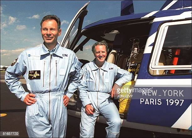 """Philippe Boutry pilot of """"L'Eesprit d'Intertechnique 1997"""" and Bernard Certain, chief engineer on the project, pose for photographers 05 June in..."""