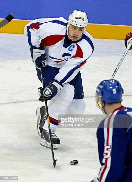 Philippe Bozon of France makes his way down the ice during the second period aganist Slovakia at the of the XIX Winter Olympics 14 February 2002 in...