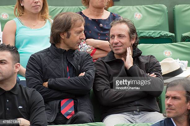 Philippe Candeloro R and guest attend the Roland Garros French open at Roland Garros on June 1 2015 in Paris France