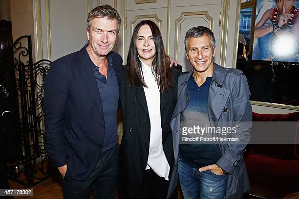 Philippe Caroit Nathalie Garcon and Nagui attend the Nathalie Garcon's Book Signing Cocktail Party At Hotel Regina on October 13 2014 in Paris France