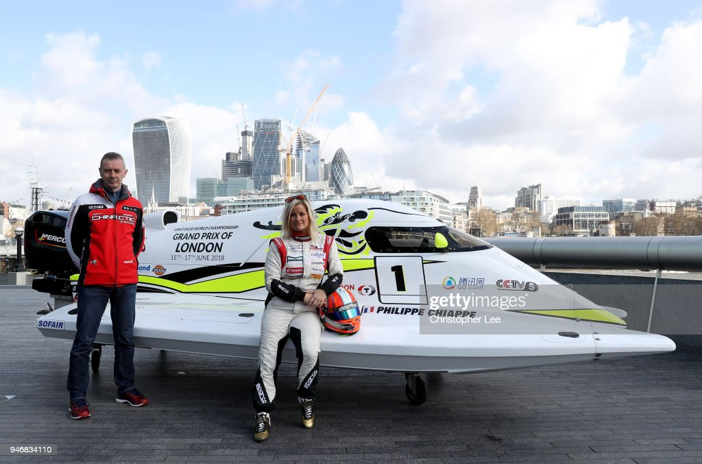 Philippe Chiappe, Professional powerboat driver and (R) Marit Stromoy, Professional powerboat driver pose for a photo with the CTIC F1 Shenzhen China boat infront of the London city skyline during the UIM F1H2O Grand Prix Of London Launch in London on April 16, 2018 in London, England.