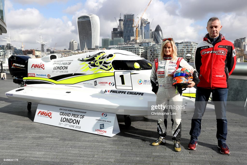 Philippe Chiappe, Professional powerboat driver and (L) Marit Stromoy, Professional powerboat driver pose for a photo with the CTIC F1 Shenzhen China boat infront of the London city skyline during the UIM F1H2O Grand Prix Of London Launch in London on April 16, 2018 in London, England.