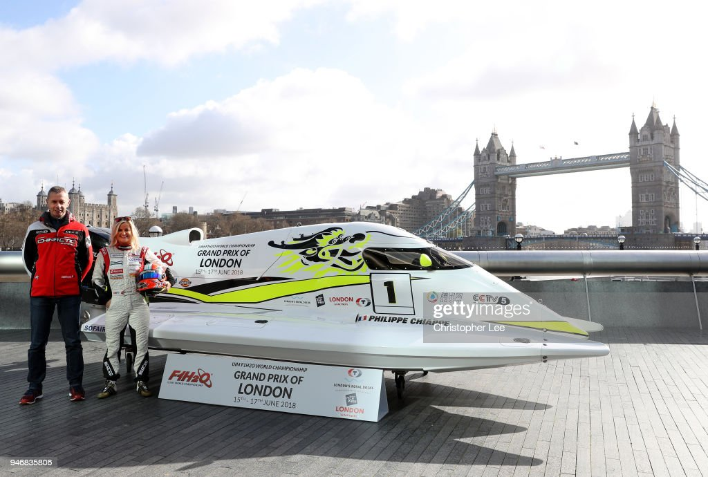 Philippe Chiappe, Professional powerboat driver and (R) Marit Stromoy, Professional powerboat driver pose for a photo with the CTIC F1 Shenzhen China boat infront of Tower Bridge during the UIM F1H2O Grand Prix Of London Launch in London on April 16, 2018 in London, England.