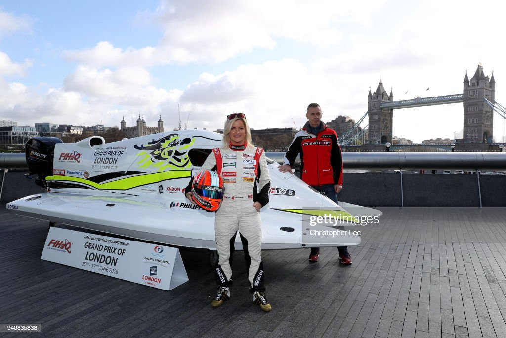 Philippe Chiappe, Professional powerboat driver and (L) Marit Stromoy, Professional powerboat driver pose for a photo with the CTIC F1 Shenzhen China boat infront of Tower Bridge during the UIM F1H2O Grand Prix Of London Launch in London on April 16, 2018 in London, England.