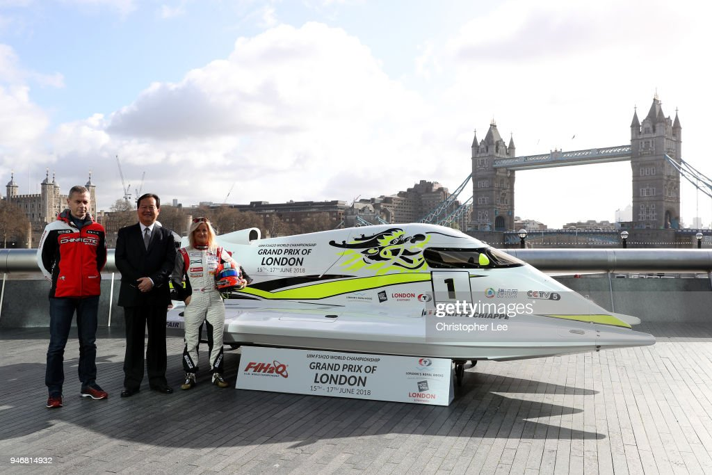Philippe Chiappe, Professional powerboat driver, Mr. Li Hajoie, Chairman of Tian Rong Sports and Marit Stromoy, Professional powerboat driver pose for a photo with the CTIC F1 Shenzhen China boat infront of Tower Bridge during the UIM F1H2O Grand Prix Of London Launch in London on April 16, 2018 in London, England.