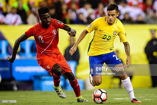 Philippe Couthino of Brazil struggle for the ball against Christian Ramos of Peru during the 2016 Copa America Centenario Group B match between...