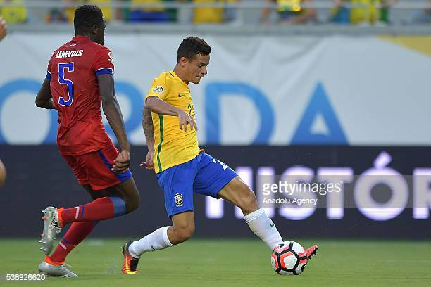 Philippe Couthino of Brazil struggle for the ball against Roman Genevois of Haiti during the 2016 Copa America Centenario Group B match between...