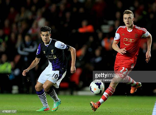 Philippe Couthino of Liverpool and Calum Chambers of Southampton chase the ball during the Barclays Premier League match between Southampton and...