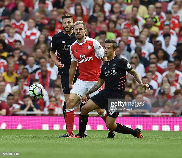 Philippe Couthino of Liverpool competes with Aaron Ramsey of Arsenal during the Premier League match between Arsenal and Liverpool at Emirates...