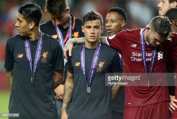 Philippe Coutinho Alberto Moreno and Roberto Firmino of Liverpool with their Premier League Asia Trophy medals after the Premier League Asia Trophy...