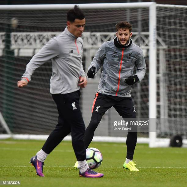 Philippe Coutinho and Adam Lallana of Liverpool during a training session at Melwood Training Ground on March 17 2017 in Liverpool England