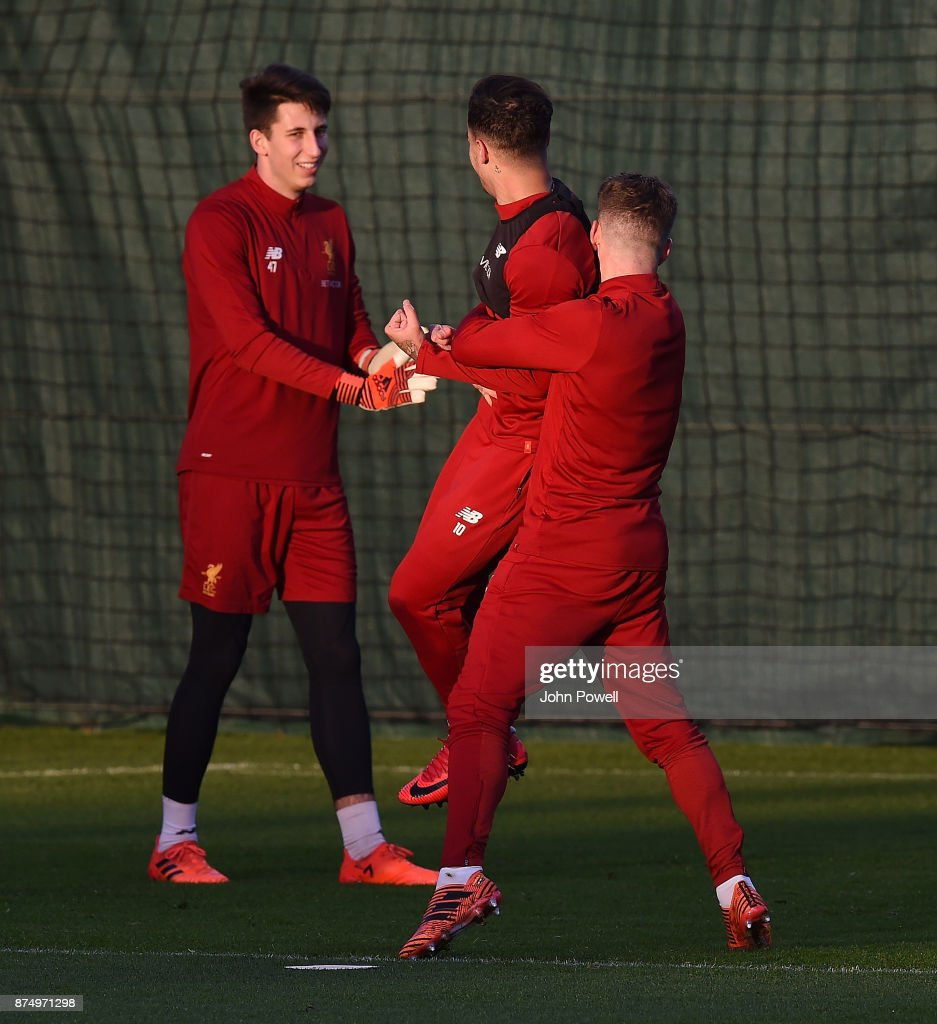 Philippe Coutinho and Alberto of Liverpool laughing during a training session at Melwood Training Ground on November 16, 2017 in Liverpool, England.