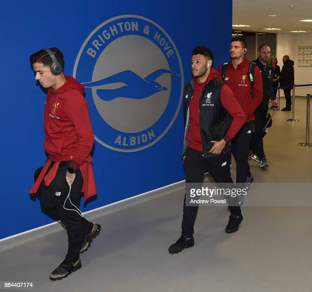 Philippe Coutinho and Alex OxladeChamberlain of Liverpool arrives before the Premier League match between Brighton and Hove Albion and Liverpool at...