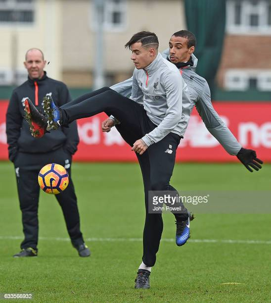 Philippe Coutinho and Joel Matip of Liverpool during a training session at Melwood Training Ground on February 2 2017 in Liverpool England