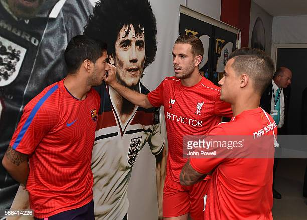 Philippe Coutinho and Jordan Henderson of Liverpool chat with Luis Suarez of Barcelona before the International Champions Cup match between Liverpool...
