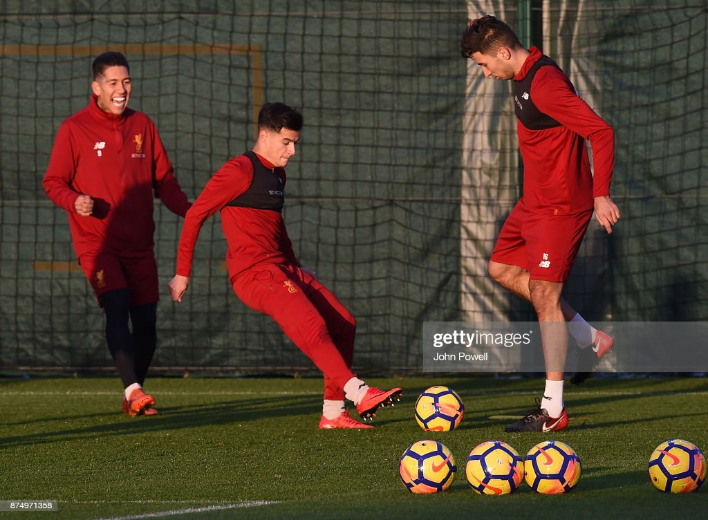 Philippe Coutinho and Marko Grujic of Liverpool during a training session at Melwood Training Ground on November 16, 2017 in Liverpool, England.