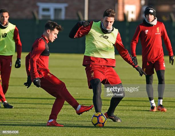 Philippe Coutinho and Marko Grujic of Liverpool during a training session at Melwood Training Ground on November 30 2017 in Liverpool England