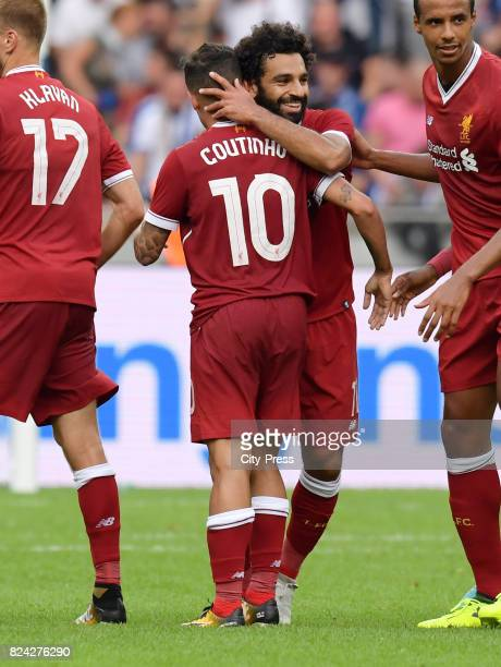 Philippe Coutinho and Mohamed Salah of Liverpool FC celebrate after scoring the 03 during the test match between Hertha BSC and Liverpool FC on july...