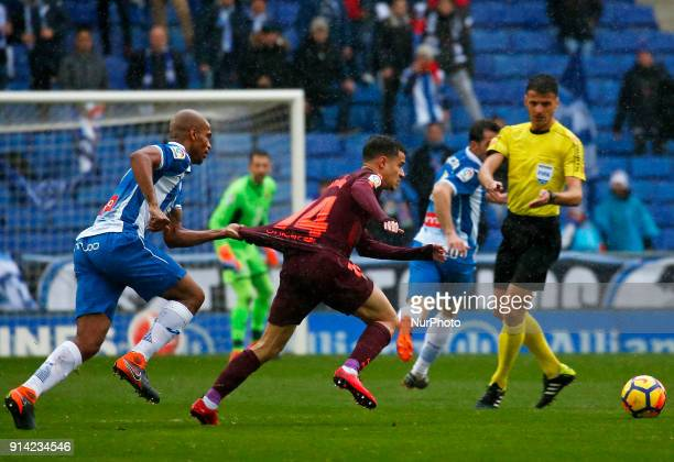 Philippe Coutinho and Naldo during the match between RCD Espanyol vs FC Barcelona for the round 22 of the Liga Santander played at Cornella El Prat...