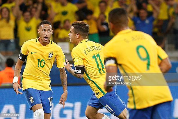 Philippe Coutinho and Neymar of Brazil celebrate after scoring a goal during the FIFA 2018 World Cup Qualifier match between Brazil and Argentina at...