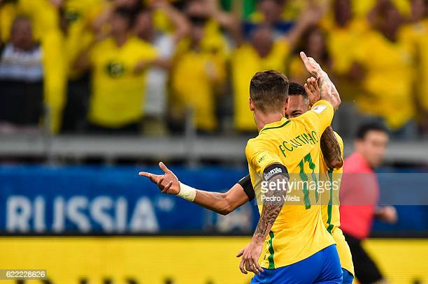 Philippe Coutinho and Neymar of Brazil celebrates a scored goal against Argentina during a match between Brazil and Argentina as part 2018 FIFA World...