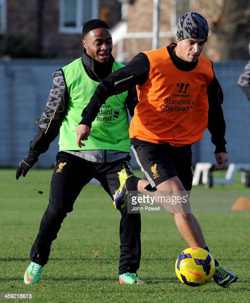 Philippe Coutinho and Raheem Sterling of Liverpool in action during a training session at Melwood Training Ground on December 24 2013 in Liverpool...