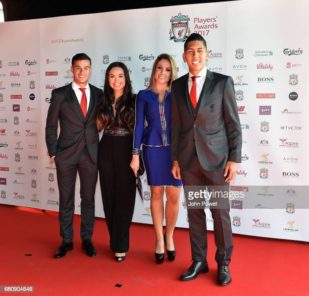 Philippe Coutinho and Roberto Firmino of Liverpool arrive at the Liverpool FC Player Awards with their wives at Anfield on May 9 2017 in Liverpool...