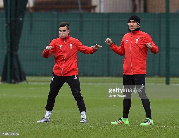 Philippe Coutinho and Roberto Firmino of Liverpool during a training session at Melwood Training Ground on March 4 2016 in Liverpool England