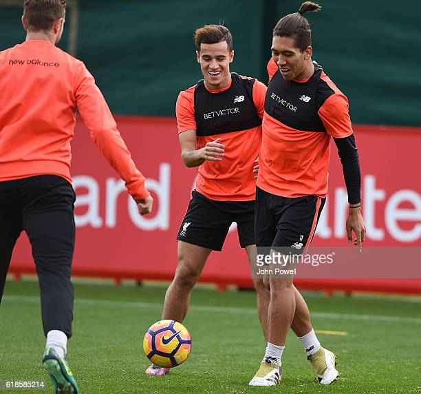 Philippe Coutinho and Roberto Firmino of Liverpool during a training session at Melwood Training Ground on October 27 2016 in Liverpool England