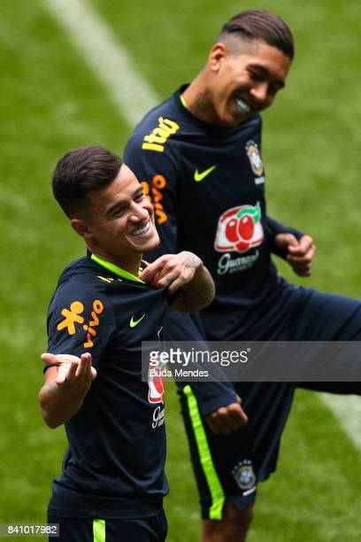 Philippe Coutinho and Roberto Firmino take part in a training session at the Arena do Gremio on August 30 2017 in Porto Alegre Brazil ahead of their...