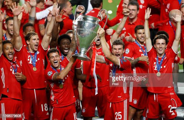 Philippe Coutinho and Thomas Mueller of FC Bayern Munich lift the UEFA Champions League Trophy following their team's victory in the UEFA Champions...