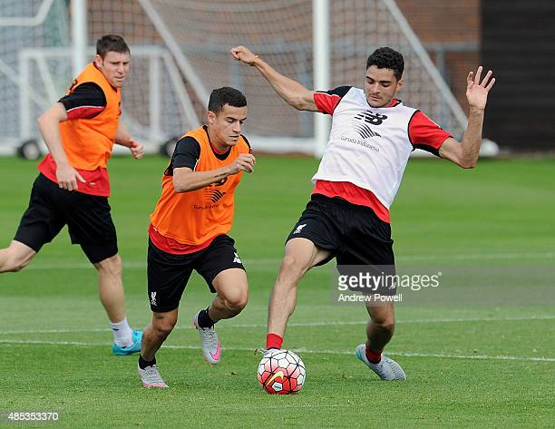 Philippe Coutinho and Tiago Ilori of Liverpool in action during a training session at Melwood Training Ground on August 27 2015 in Liverpool England