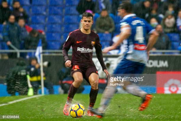 Philippe Coutinho and Victor Sanchez during the match between RCD Espanyol vs FC Barcelona for the round 22 of the Liga Santander played at Cornella...
