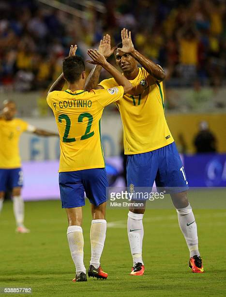 Philippe Coutinho and Walace of Brazil celebrate winning a Group B match of the 2016 Copa America Centenario at Camping World Stadium on June 8 2016...