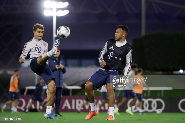Philippe Coutinho is challenged by Corentin Tolisso during a training session on day three of the FC Bayern Muenchen winter training camp at Aspire...